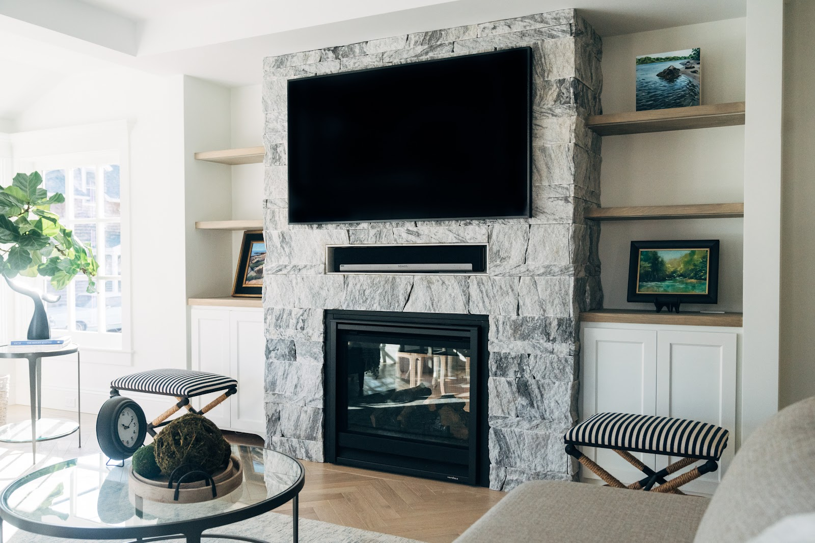 Indoor fireplace clad in Pearl Grey marble veneer