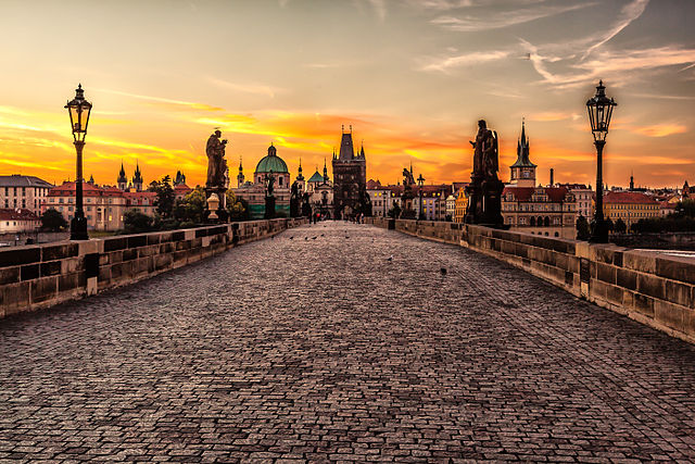 Picture of wide cobbled street bridge in Prague sunset: most beautiful luxurious hotels