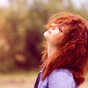 Enjoying nature by Livio Siano - People Portraits of Women ( girl, red, nature, green, beautiful, redhead, sunshine, flowers )