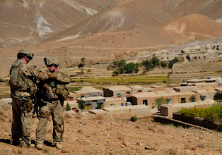 Photo: FARAH, Afghanistan 110926-F-JP934-057 / U.S. Army Sgt. Peter Lescord, from Brookefield, Mass. (Left), and Spc. Michael Leone, from Quincy, Mass., of 1-182 Infantry Regiment, Charlie Company, security force for Provincial Reconstruction Team Farah, make some adjustments on Spc. Leone's body armor,  Purchaman District, Farah Province, Afghanistan, Sept. 26. PRT members escorted members of Farah's Provincial Government to a shura where elders resolve community issues and communicate concerns to the provincial government. PRT Farah attends shuras throughout Farah Province to demonstrate support for the shura elders, the district governor and provincial governance. (ISAF photo/ USAF SrA Alexandra Hoachlander)