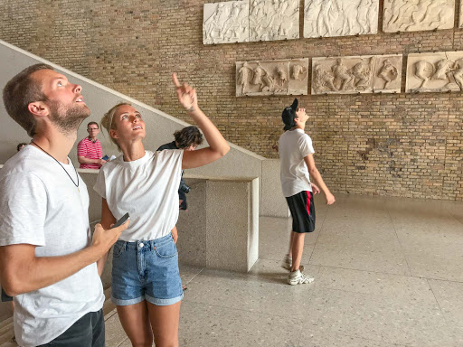 Visitors-to-Neues-Museum.jpg - Visitors to the Neues Museum admire reliefs on the ceiling and walls.