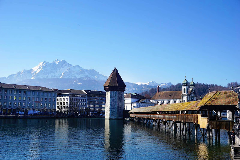 The waterfront in Lucerne, Switzerland, with the Alps in the background.
