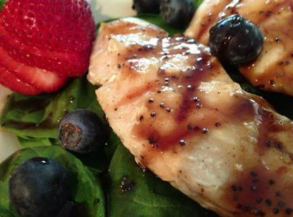 Grilled Chicken With Fresh Strawberries And Blueberries Over A Bed Of Spinach With Strawberry Balsamic Glaze