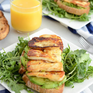 Avocado Toast with Grilled Halloumi and Honey.