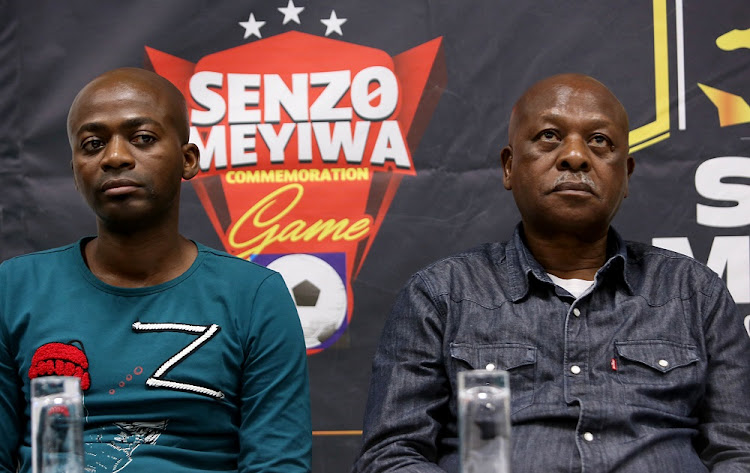 Late Senzo Meyiwa's older brother, Sifiso, and his father Sam.