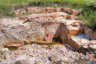 Photo: Once the pipestone is exposed, care must be taken in removing the stone as it is very fragile and when handling large slabs it can break.