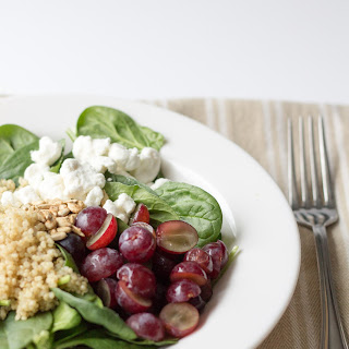 Spinach Quinoa Salad with Grapes and Goat Cheese.
