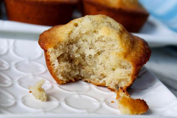 Banana Bread Muffin With A Bite Taken Out.