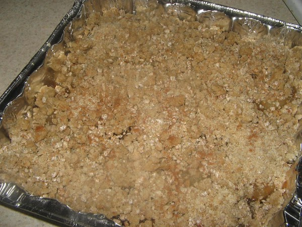 Press 1/2 the  mixture in the bottom of the prepared baking pan. Spread the...