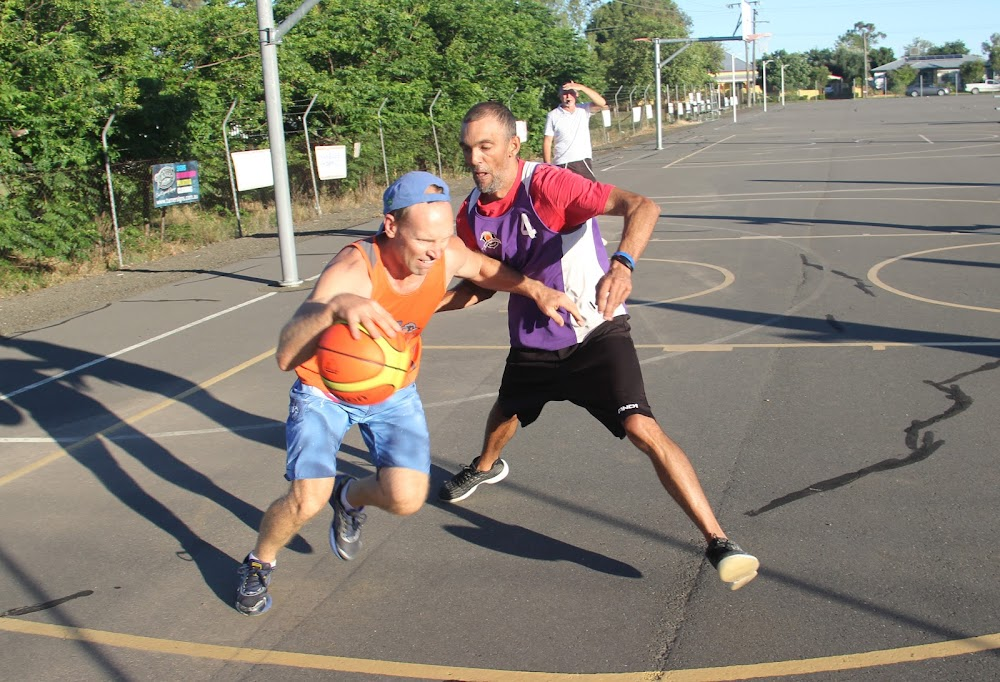 Wilga's Mick Skalij attempts to dribble past Namoi Hotel's Steve Berger in Tuesday afternoon's Narrabri Basketball Association mixed grand final.