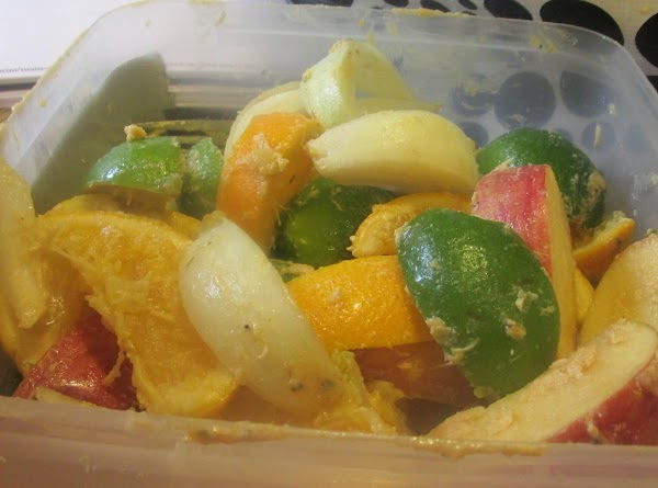 Quarter all the fruits and veggies, and then fill the neck cavity with some...