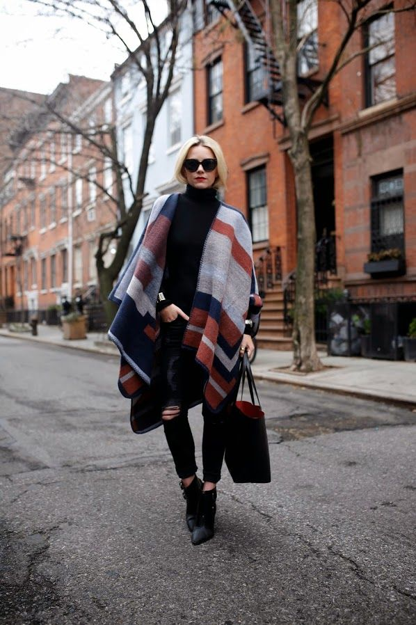 scarf worn as oversized poncho
