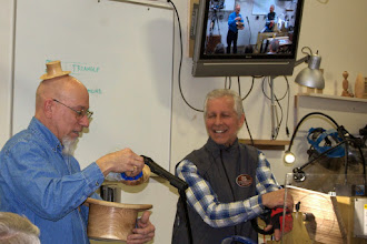 Photo: Yes it will!  Mike Sorge enjoys seeing Mike Colella showing his oak and maple turned hats, large and small.