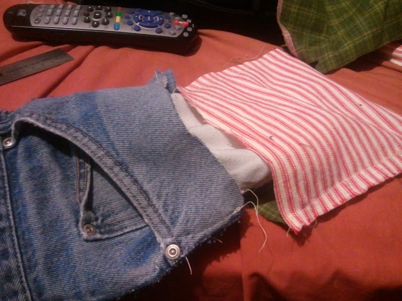 Photo: i sewed 3 sides of the denim and flannel leaving a pocket for the jean pants pocket