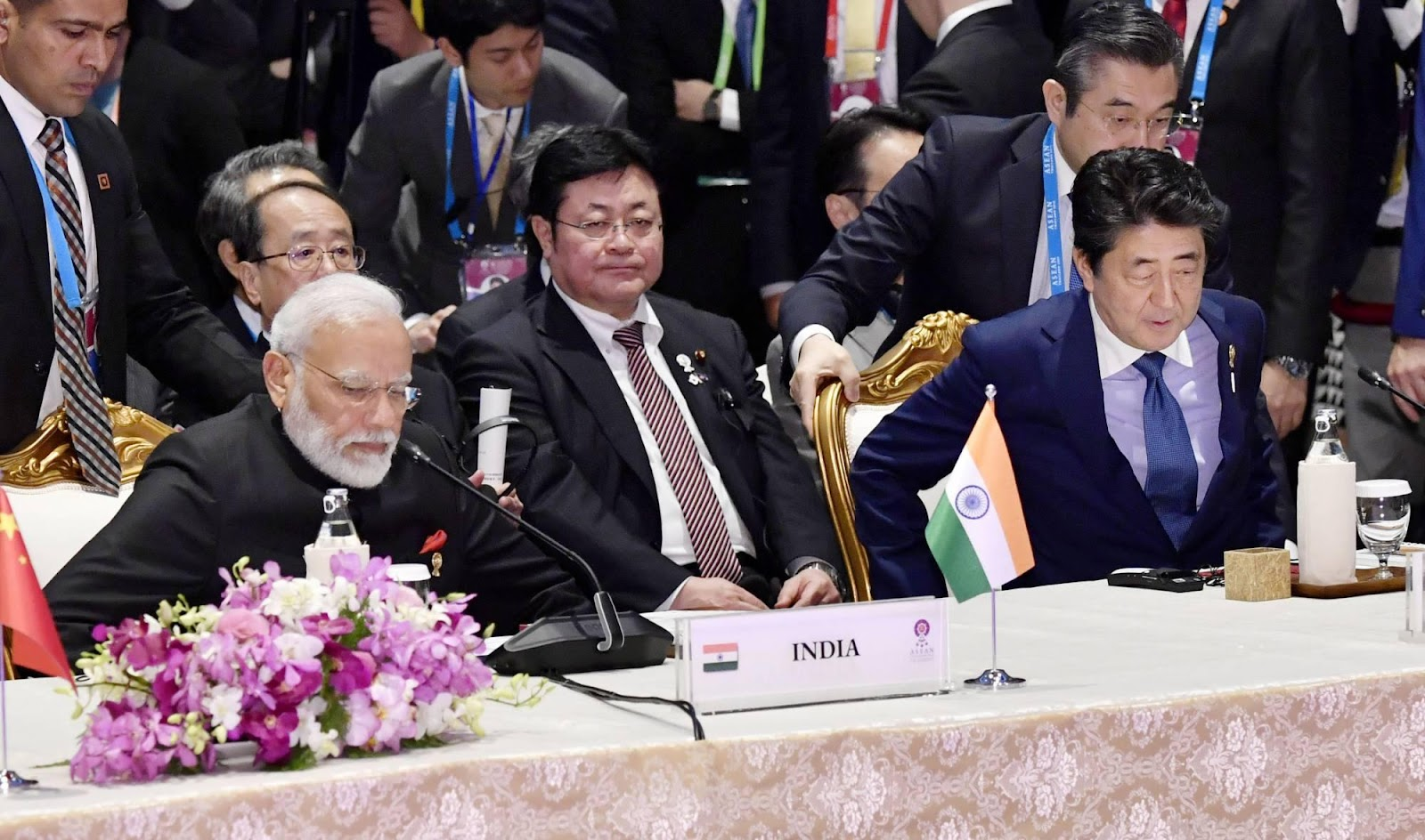Prime Minister Shinzo Abe and his Indian counterpart Narendra Modi attend a regional summit on the outskirts of Bangkok in November 2019. | KYODO