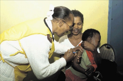 Julia Mokale had a busy day at the Olivenhoutbosch Community Hall near Centurion during the launch of a mass immunisation campaign for polio and measles yesterday, an addition to the routine immunisation programme that is carried out by clinics throughout Gauteng. PIC: PETER MOGAKI. 26/07/2004. © Sowetan.