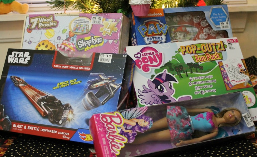 5 Preschool Toys $10 and under, perfect for donating this Christmas: Paw Patrol game, Shopkins puzzles, Star Wars Hot Wheels Launcher, My Little Pony art set, and a Barbie doll!