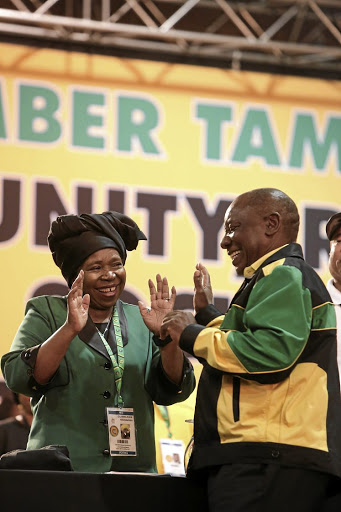 Nkosazana Dlamini-Zuma and Cyril Ramaphosa share a moment at the ANC's elective conference.