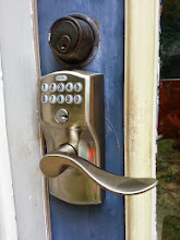 Photo: Yeah it does not match. The house hardware is all antique brass that is now really antique (as in 25 years+). The lock only came in bronze and nickel. I guess I should have ordered bronze. Oh well.