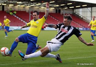 Photo: Dunfermline Athletic v Morton Irn Bru First Division East End Park 20 October 2012Jordan McMillan tries to cross past former par David Graham(c) Craig Brown | StockPix.eu