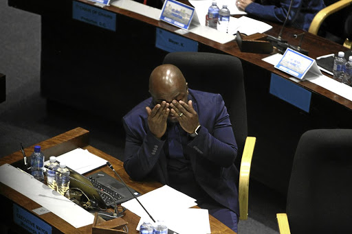 Can't bear to watch: Tshwane mayor Solly Msimanga survived the motion of no confidence.