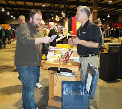 Photo: Chris reviewed the information in a Woodcraft brochure with an interested customer.