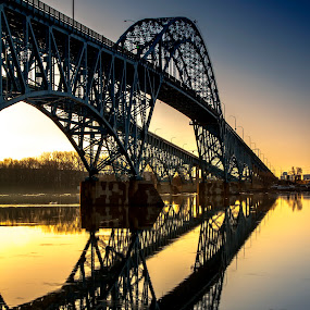 Over the River by John Witt - Buildings & Architecture Bridges & Suspended Structures ( grand island south, reflection, arch, sunrise, river,  )
