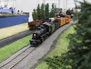 Photo: CNR Mogul #83 drags a short freight past Marshall's Siding. The 2-6-0 is a brass kit from S Scale Loco & Supply. The SW9 in the background is RTR from S Helper Service.