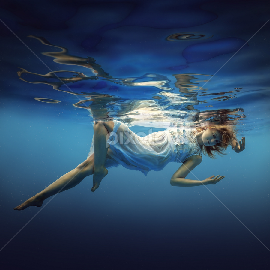 Grace by Dmitry Laudin - People Fashion ( water, hand, reflection, blue, underwater, bubbles, white, floating, bliss, smile, hair, light )