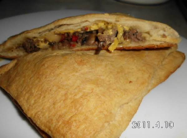 This One Is With Meat, Cheese, Onion, Mushroom & Red Bell.  Yummy Aurora