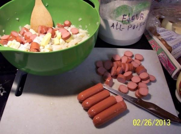 Slice frankfurters add to potatoes.Add parsley, celery salt, and a dash of paprika.