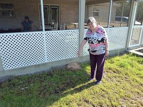 Photo: Irmgard pointing at bear droppings