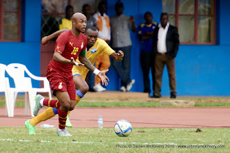 Photo: Andre Ayew (10) calls for support as Jacques Tuyisenge (9) closes in [Rwanda Vs Ghana AFCON2017 Qualifier, 5 Sep 2015 in Kigali, Rwanda.  Photo © Darren McKinstry 2015