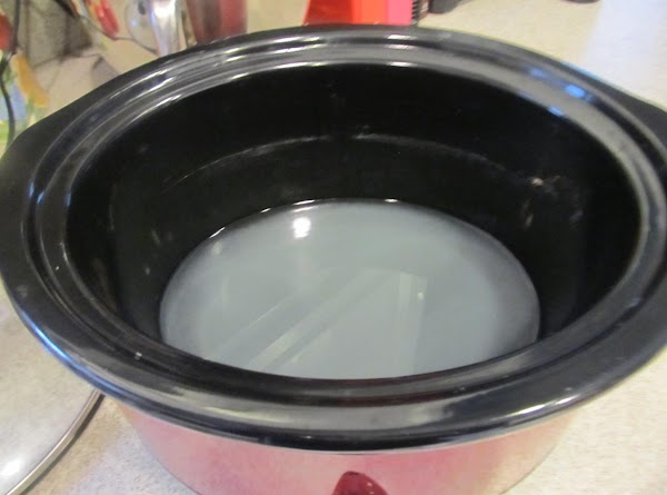 In Crock Pot pour in 2 cups of broth and wine.Place the chicken into...