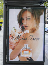 Photo: You won't see any big American stars shilling at US bus stops, but that's no barrier to Natalie Portman going commercial in Paris.