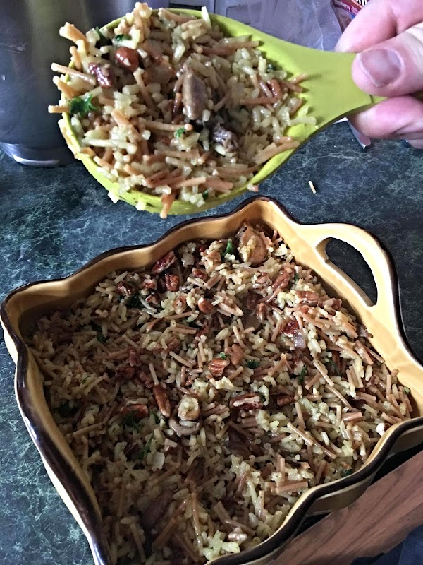 Set aside 3/4 cup of the rice mixture.  Spoon remaining rice mixture into...