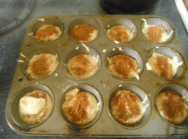 NOW FILL MUFFIN TINS 2/3 FULL AND THEN AFTER U GOT ALL MUFFIN HOLES...
