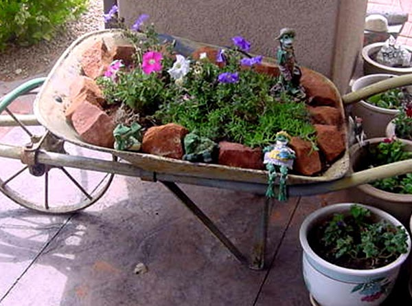 My wheelbarrow planter.  Another $5 find from a garage sale in CA.