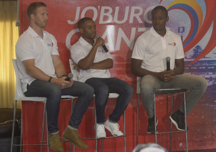 Joburg Giants players Andre Malan (L), Temba Bavuma (M) and Kagiso Rabada (R) during the launch and team Introduction at The Long Room, Wanderers Cricket Stadium on August 30, 2017 in Johannesburg, South Africa.