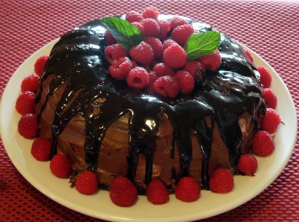 Frost sides of cake with chocolate frosting, sealing cut edges.  Microwave any leftover...