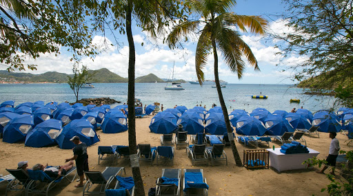 beach-bbq-st-lucia.jpg - Windstar umbrellas and cots set up for a beach barbecue on Pigeon Island, St. Lucia.