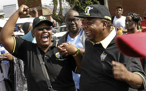 WE WON   An elated Lawrence Dube, right,  leaves the Pietermaritzburg High Court  following the outcome of the court case on Tuesday  Picture: Khaya Ngwenya