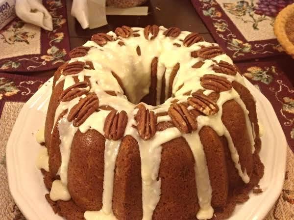 Orange Sweet Potato Pound Cake With Orange Butter Glaze, & Topped With Pecan Halves.