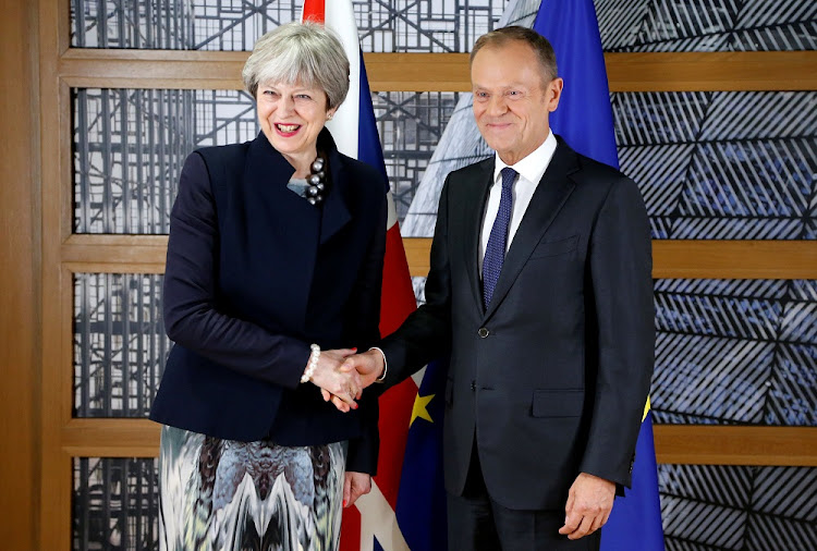 British Prime Minister Theresa May and European Council president Donald Tusk pose ahead of a meeting in Brussels, Belgium, on December 4 2017. Picture: REUTERS