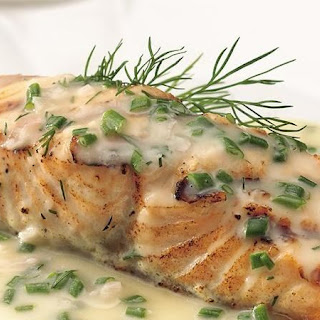 Grilled Salmon with Lemon-Herb Butter Sauce.