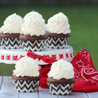 Cocoa Cupcakes with White Chocolate Frosting.
