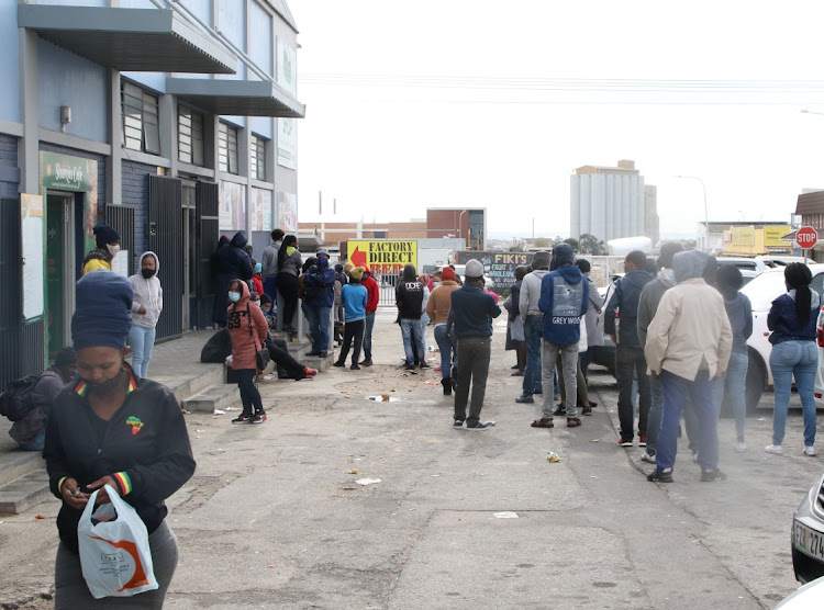 People wait for R350,00 grants at Korstern Post Office in Gqeberha. File photo: FREDLIN ADRIAAN