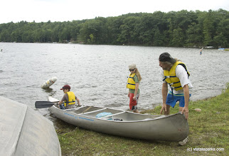 Photo: Matthew Broad of Putney, VT ends aweekend camping trip with a canoe trip with his sons,  Aja and Kaelan Selbach-Broad, at Bomozeen State Park. Photo by Karen Pike