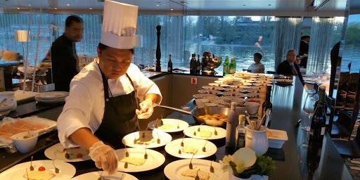 scenic-jade-cuisine.jpg - A chef prepares a new course for guests aboard Scenic Jade.