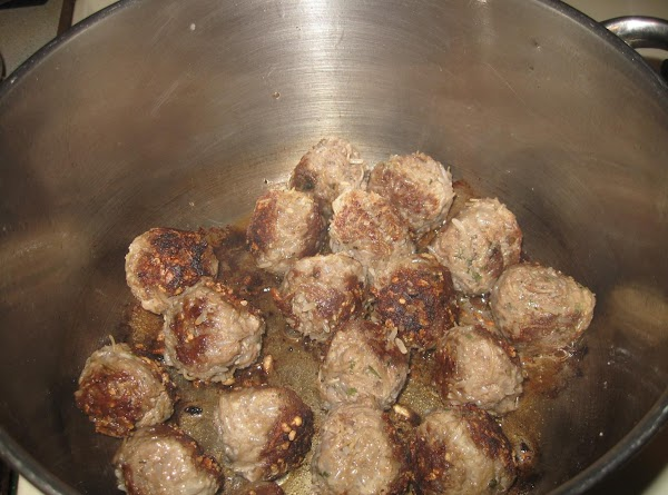In a large pot or skillet, brown meatballs on all sides. Remove from pan...